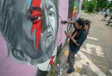 Grafitero RD pintan covid19 en de muros de Berlín